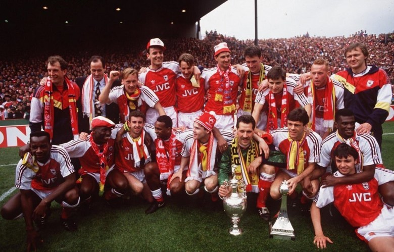 George and his team celebrate winning the Title in 1991George and his team celebrate winning the Title in 1991