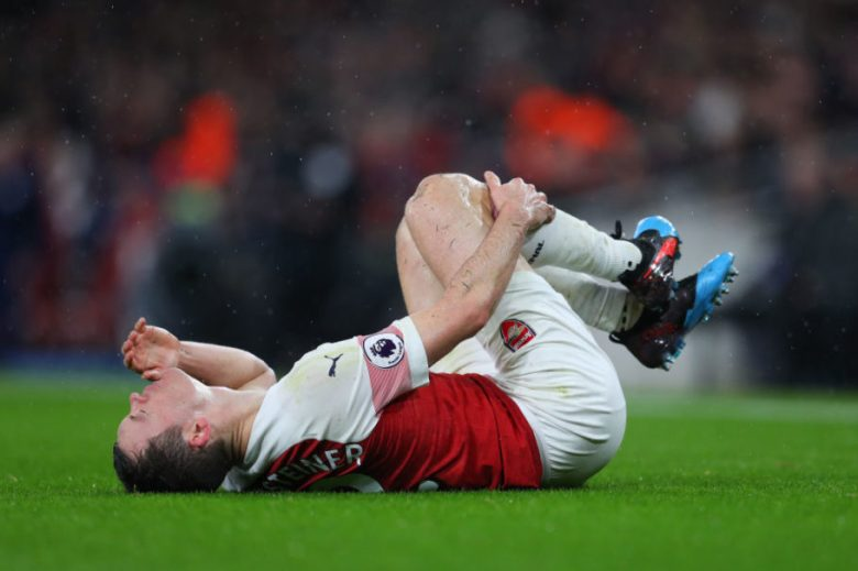 LONDON, ENGLAND - JANUARY 29: An injured Stephen Lichtsteiner of Arsenal during the Premier League match between Arsenal FC and Cardiff City at Emirates Stadium on January 29, 2019 in London, United Kingdom. (Photo by Catherine Ivill/Getty Images)
