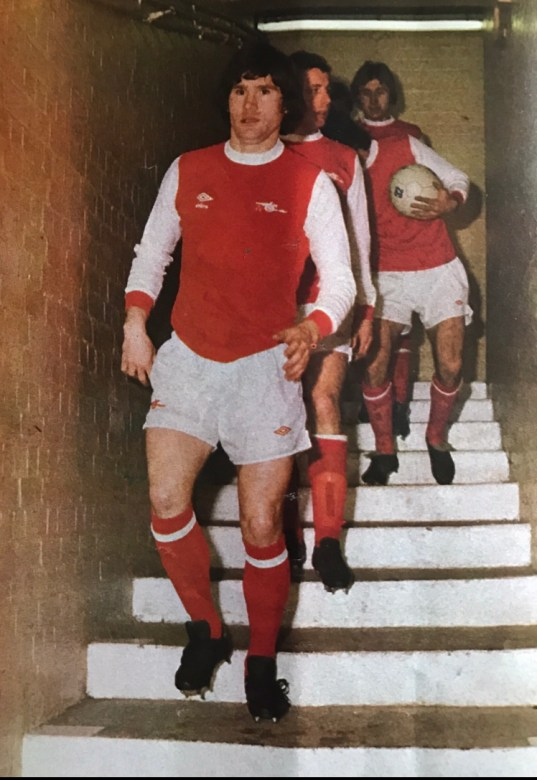 Pat leads the team out down the tunnel at Highbury