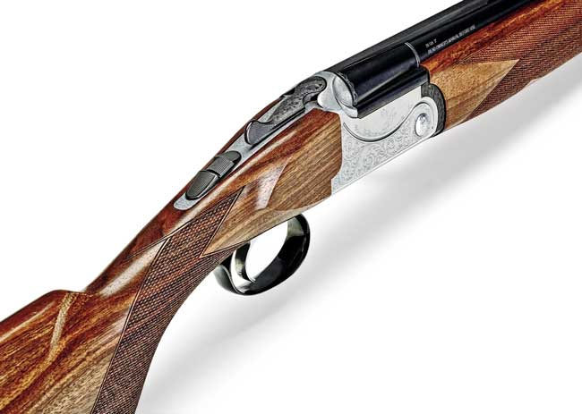 The nicely sculpted receiver is tastefully decorated with bobwhite quail and extensive scrolling. It's fitted with a single selective inertia trigger.