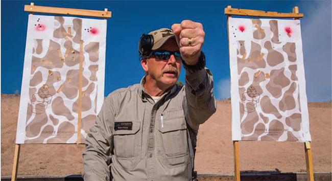 Rangemaster Bob Whaley discusses the importance of grip ahead of a drill to help shooters determine the appropriate amount of pressure to apply.