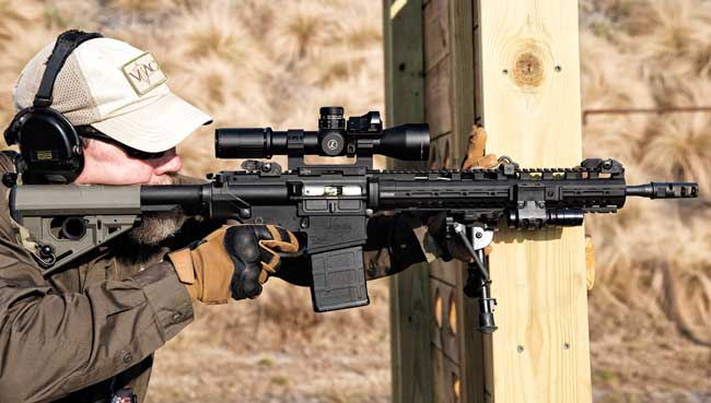 Here, the bipod is used to gain improved stability while using cover. Pressure is pushed from the rear of the gun into the wall, helping to control recoil.