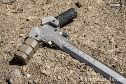 Avalanche charging handle on dirt with two wings