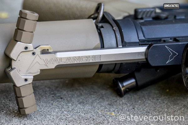 Avalanche charging handle extended from rifle with FDE wings