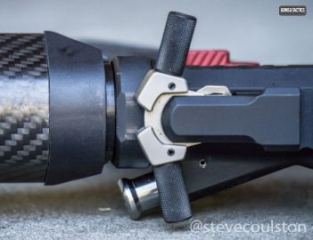 Avalanche charging handle in rifle on side with black knurled wings