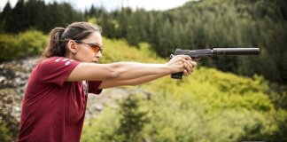 Blanca shooting a suppressed pistol