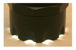 A scalloped head allows the user to immediately tell if the flashlight was left on, preventing the needless drain of batteries.