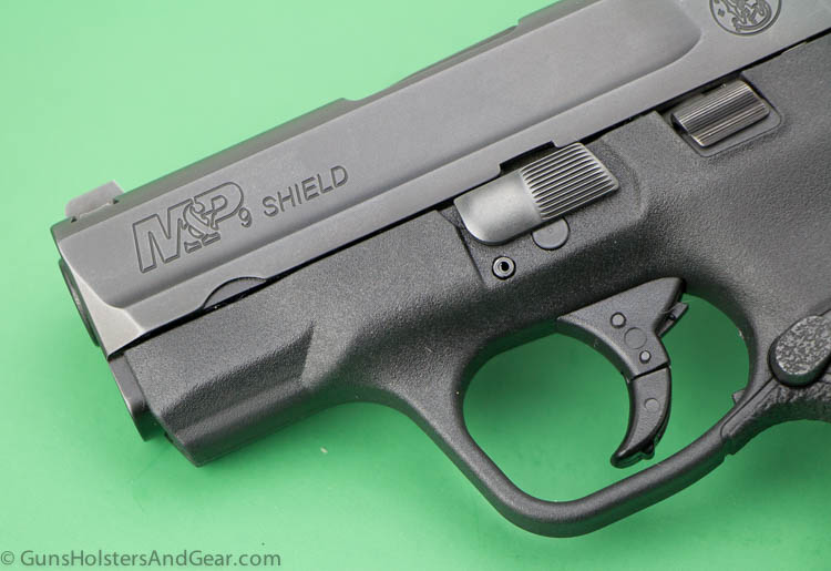 Shield slide and trigger
