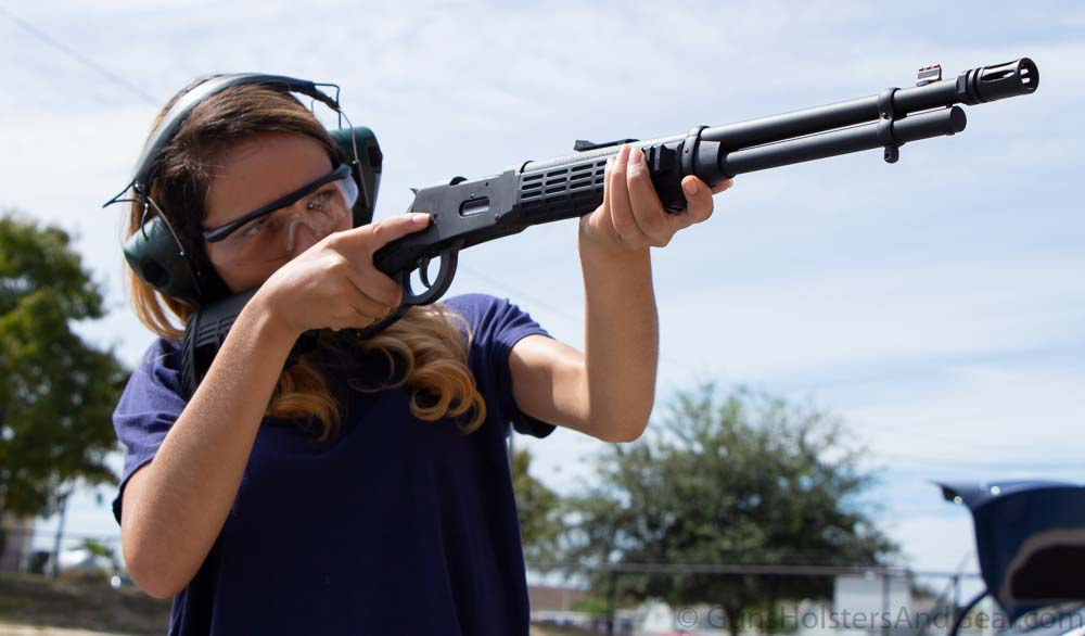 Beautiful Woman Shooting Mossberg Lever Action Rifle