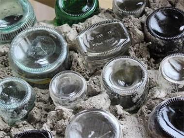 Caliu Earthship Hotel - walls made of bottles