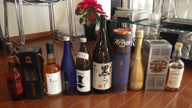 A variety of alcoholic beverage bottles