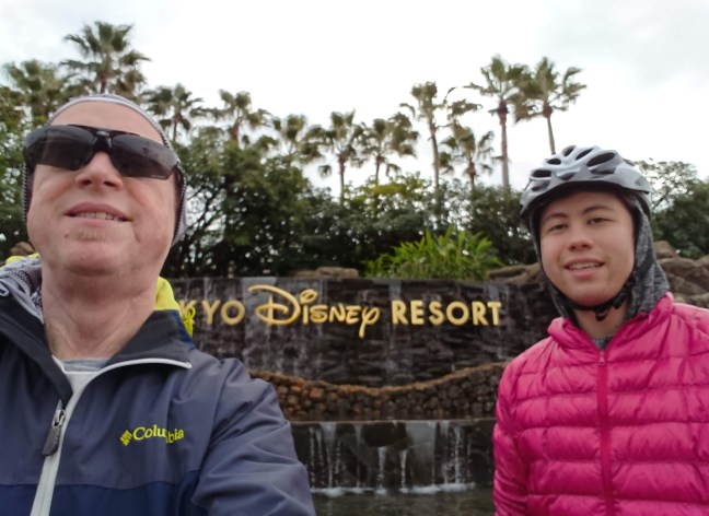 Two happy riders in front of the Tokyo Disney Resort fountain
