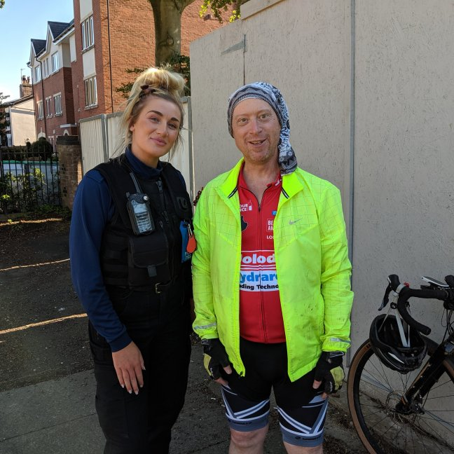 Peace officer and very tired cyclist