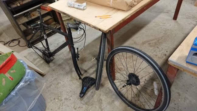 Bike dissassembled on workshop floor