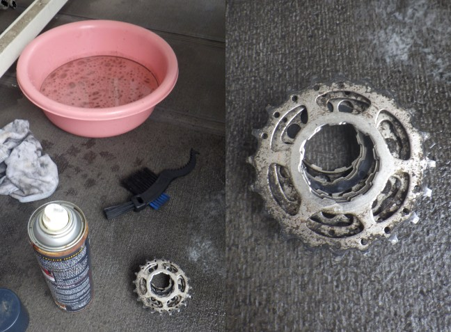 Dirty bicycle sproket with degreaser, brush and tub of greasy water