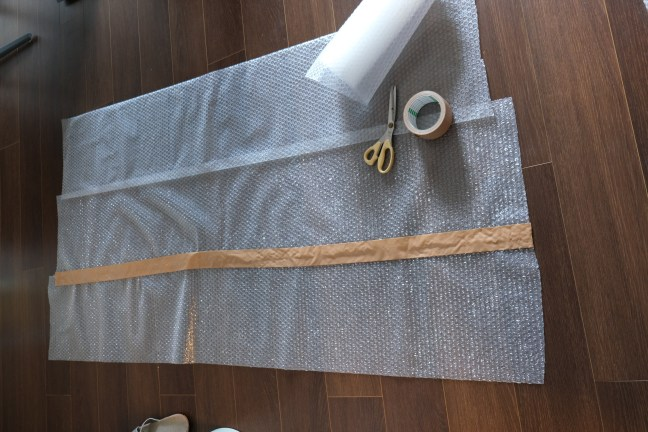 Taping together sheets of bubble pack