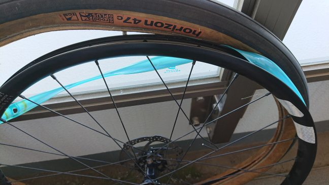 Bicycle wheel with tire removed and rim strip partially removed