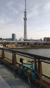 Bicycle on pedestrian bridge with Tokyo Skytree in background