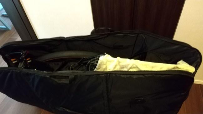Bike bag zipper open showing shop towel over bike chain and wheel