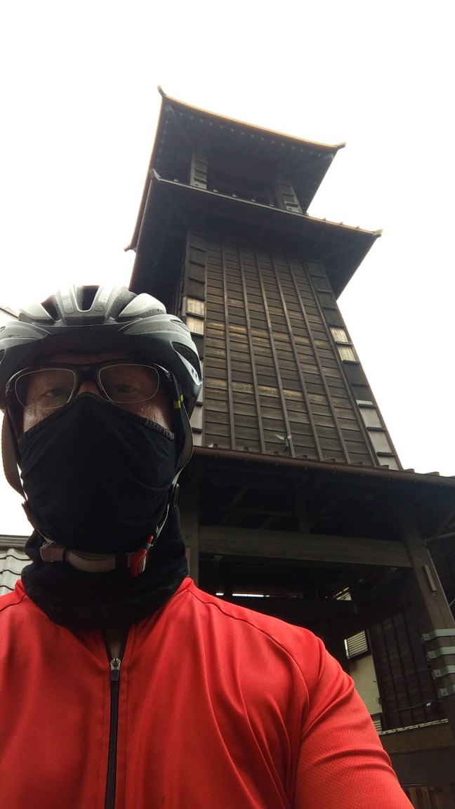 Selfie of cyclist in front of Toki no Kane bell tower in Kawagoe