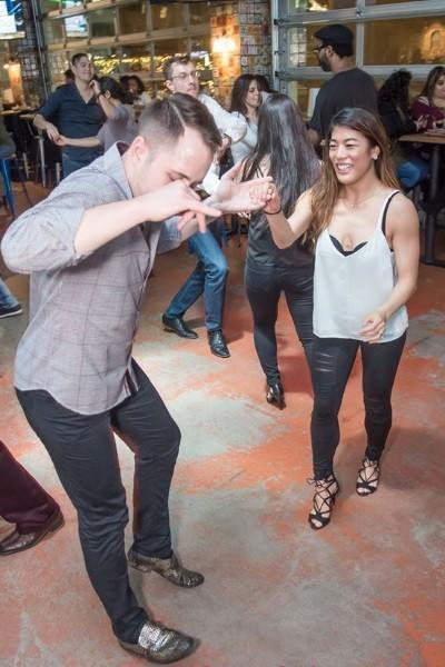 https://gooddeedseats.com/images/best-latin-clubs/LatinStreetMusicDancing.jpg