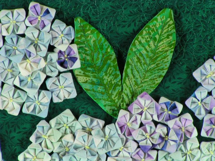 Detail of a hydrangea blossom made from folded fabric