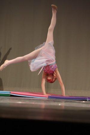 Mikayla performs a cartwheel