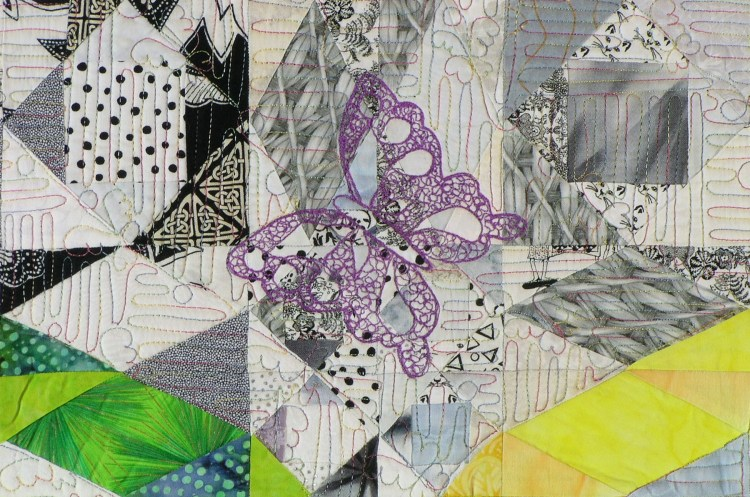 This is an image of the intricate detailed filler quilting on small section of Out of the Ashes. Here the thread painted purple butterfly and background quilting are both visible.