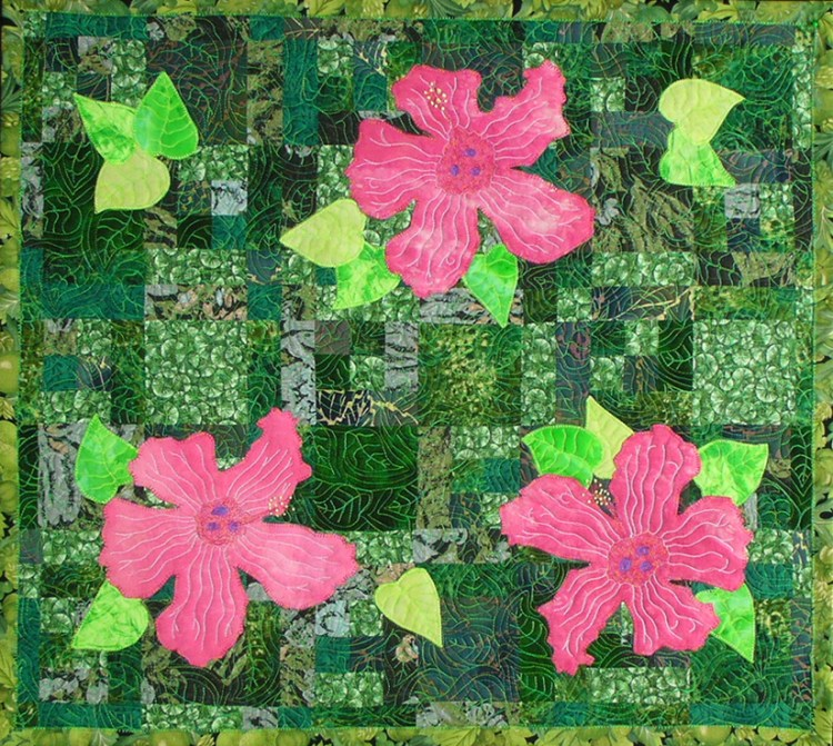 Three pink hibiscus are featured against a mixed green background