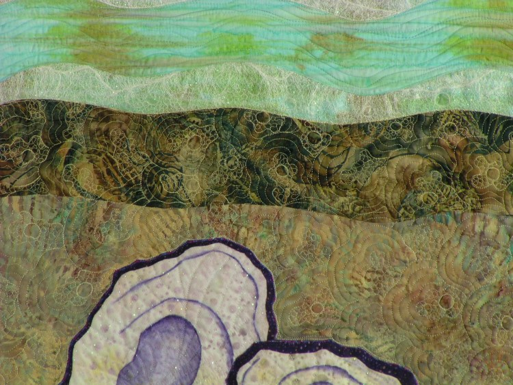 Close up of two of the upper portionof two of the oyster shells and the surf beyond