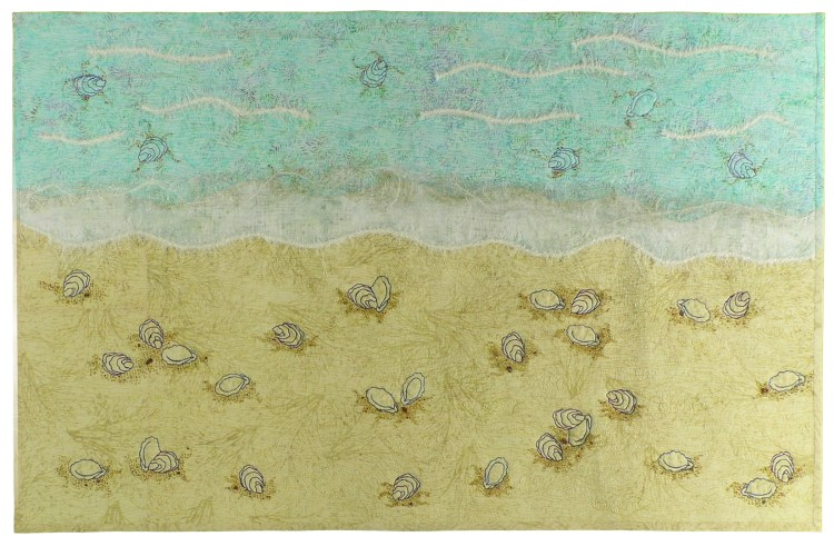 Image of a beach littered with shells , individually thread painted on the artwork