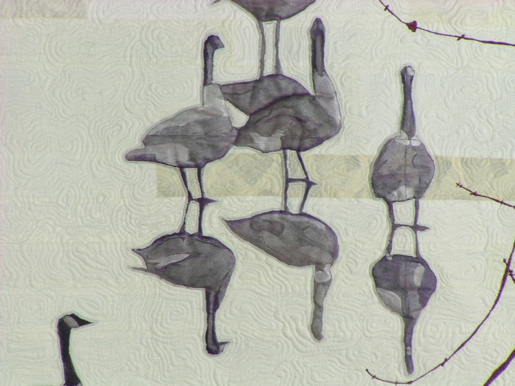 Detail of a a grouping of geese showing the detailed hand painting and intricate free motion quilting