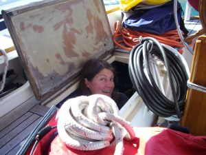 Photo: stowing gear on a crushing sailboat.