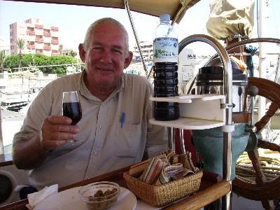 Photo: David samples a vino tinto (red wine) in Adra, Spain. Credit: Lisa Borre.