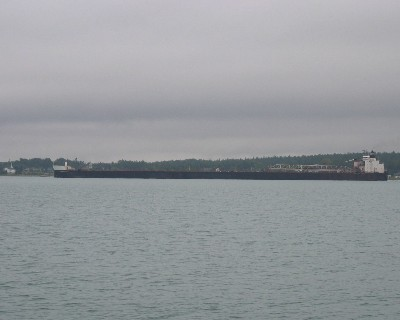 Photo: Freighter in Detour Passage bound for the open waters of Lake Huron. Credit: L. Borre.