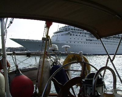 Photo: A cruise ship passes behind us while moored in Mahon, Menorca, Balearic Islands, Spain. Credit: Lisa Borre.