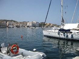 Photo: Town quay in Porto Vechio, Pantelleria, Italy. Credit: Lisa Borre.