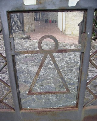 Photo: The symbol of the God Tanit depicted on an iron gate at the archeological museum in Sant Antioco. Credit: Lisa Borre.