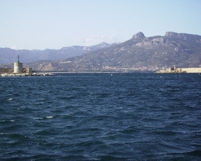 Photo: Harbor entrance in Arbatax, Sardinia. Credit: Lisa Borre.