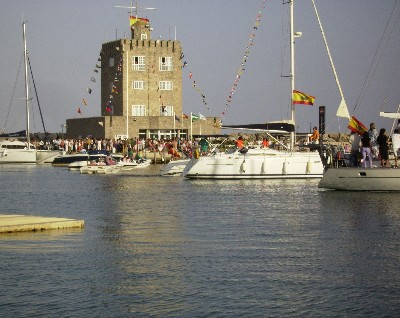 Photo: A parade of boats in Sotogrande during the July festival in honor of Carmen, the patron saint of sailors. Credit: Lisa Borre.
