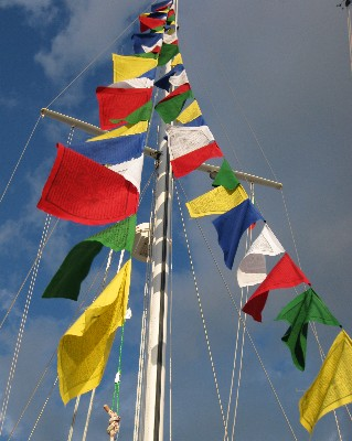 Photo: Tibetan prayer flags on s/y Gyatso. Credit: Lisa Borre.