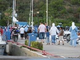 Photo: Dock walkers in Sidi Bou Said, Tunisia. Credit: Lisa Borre.