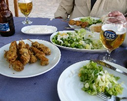 Photo: Fried mussels and beer on Marmara Adasi, Turkey. Credit: Lisa Borre.