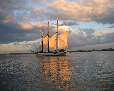 Photo: A schooner from Thunder Bay sets sail at sunset in Toronto harbor. Credit: L. Borre.