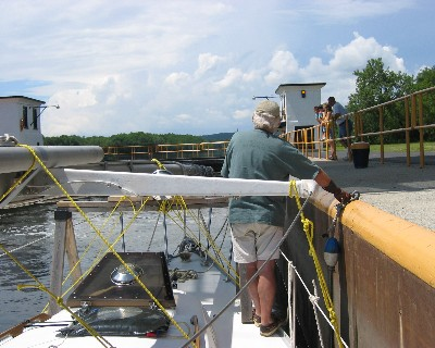 Photo: Fending off the lock wall, Erie Canal. Credit: L. Borre.