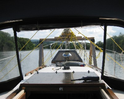 Photo: view from deck with mast lashed to sawhorses on deck. Credit: L. Borre.