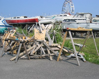 Photo: Graveyard for discarded mast holders at the marina in Oswego, New York. Credit: L. Borre.