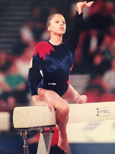 Zita Lusack gymnast competing on beam