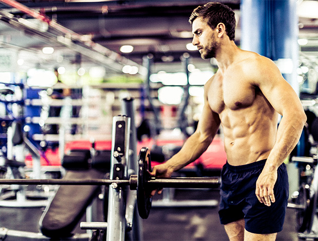 man with muscle in gym
