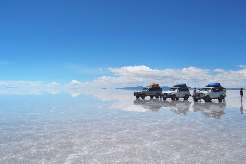 salar-de-uyuni-bolivia-flooded-water-reflection-stunning-jeeps-sky-2